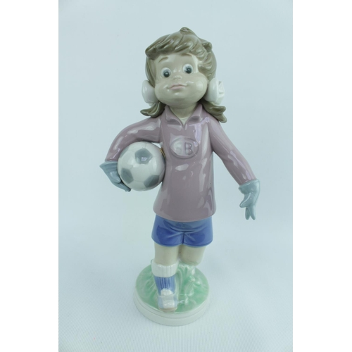 140 - Lladro 'Sports Lilly Football', Sculptor: Jose Roig, Model 01005134, Introduced in 1982 and Retired ...