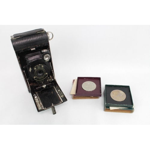 228 - Kodak No. 1 Pocket camera and assorted coins...