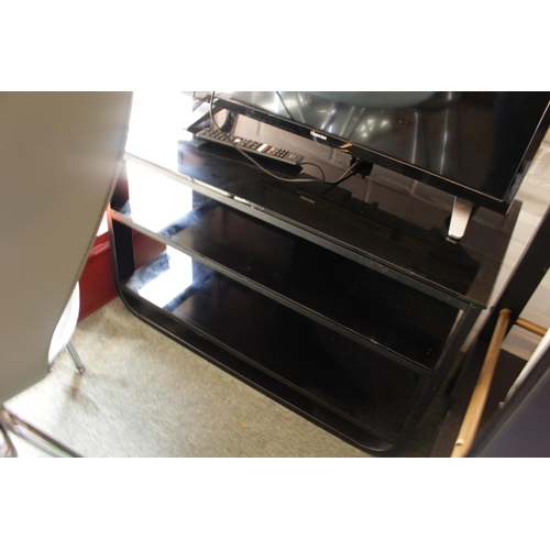 44 - Black Glass TV stand...