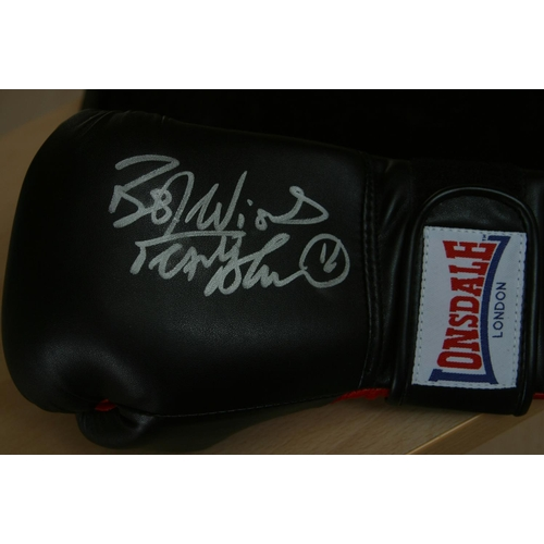 1 - Two signed full size boxing gloves: Title boxing glove personally signed by George Foreman and a you...