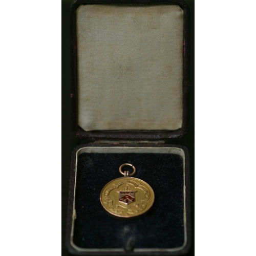 29 - A 9ct gold medal for the