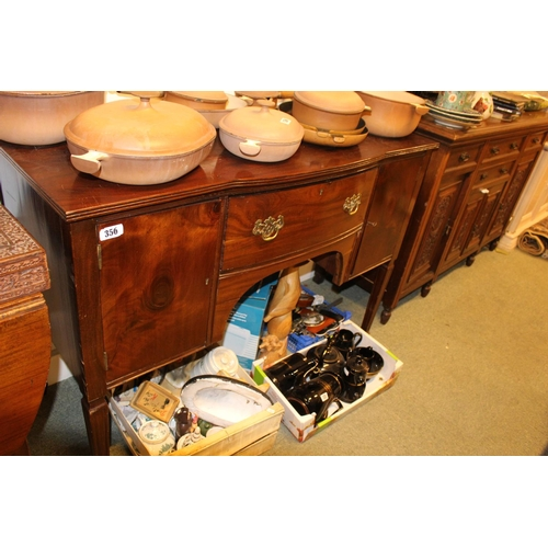 356 - 19thC Mahogany serpentine fronted sideboard with brass drop handles and tapering legs...