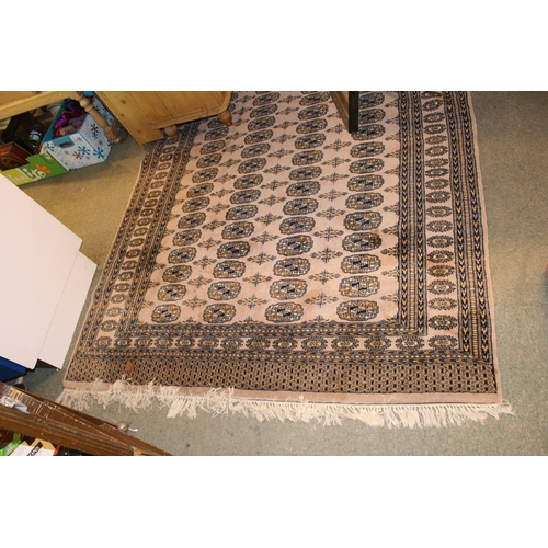384 - Large Cream ground Rug with repeating medallion design...