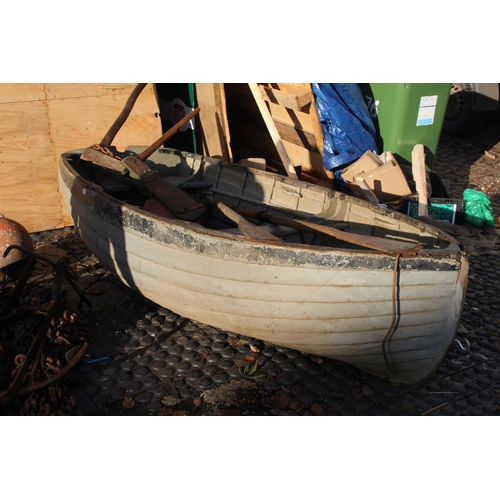 27 - Wooden planked, Ply rowing boat with Oars and Rudders...