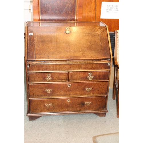 354 - Good Quality fitted Oak Fall front Bureau with fitted interior and brass drop handles...