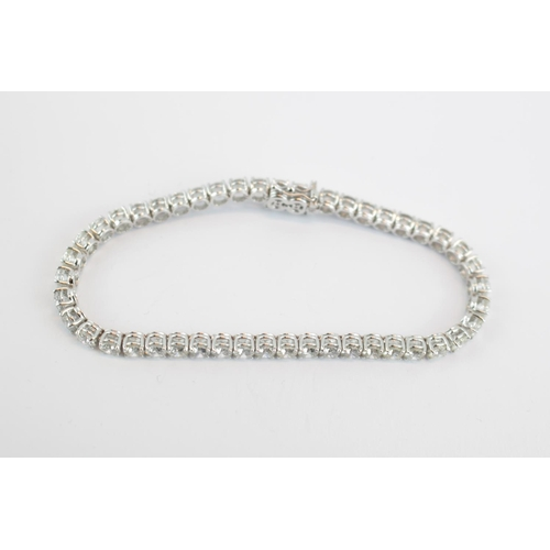 285 - A Impressive 18ct White Gold Diamond Set Tennis Bracelet 10.80ct total approx comprising of 46 Round...