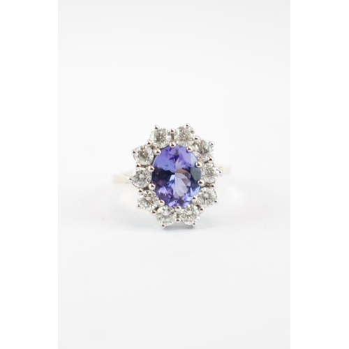 286 - Ladies 18ct Yellow Gold Tanzanite and Diamond Cluster Ring. Tanzanite 2.46ct surrounded by 10 Round ...