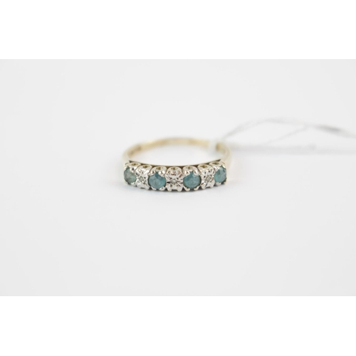 292 - Ladies 9ct Gold Diamond & Blue Cut Stone ring in carved setting, 2.5g total weight Size R...