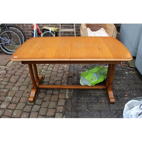 13 - Oak extending dining table...