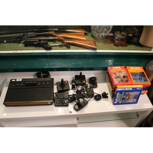 35 - Atari Video Computer System with controllers and 14 Games...
