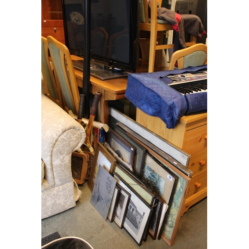 43 - Collection of assorted pictures, 2 Cased Snooker cues and 2 rackets...