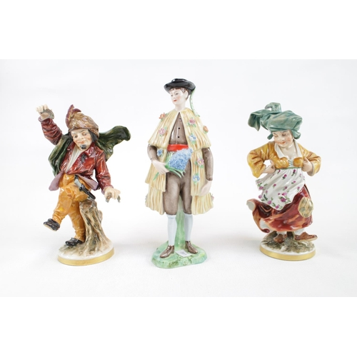 131 - 2 Early 20thC Naples porcelain figures and another figurine...