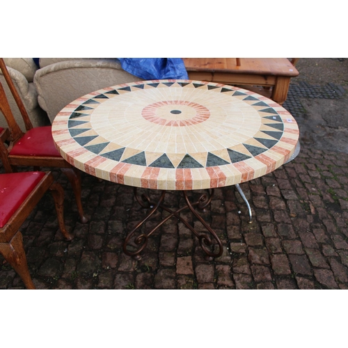 6 - Modern Conservatory dining table of inlaid sunburst design on wrought metal base...