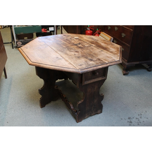 435 - Interesting Art & Crafts Gateleg table of Single drawer with shaped supports, 105cm in Diameter...
