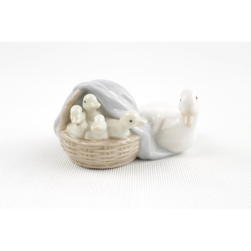 53 - Lladro figure of a Duck and Ducklings in a Basket...