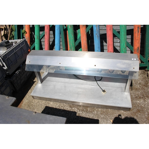 10 - Long Stainless steel serving unit with lighted canopy...