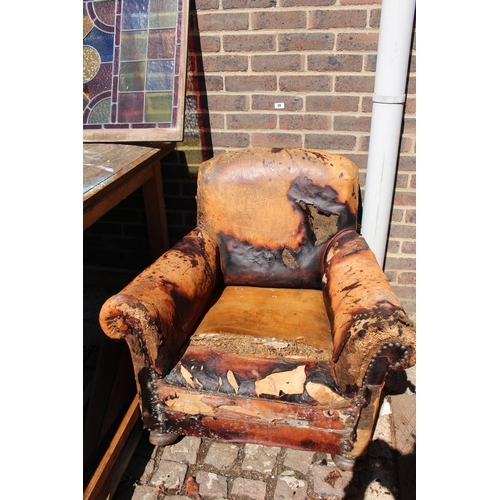 18 - Early 19thC Heals style Leather club chair on wooden bun feet...