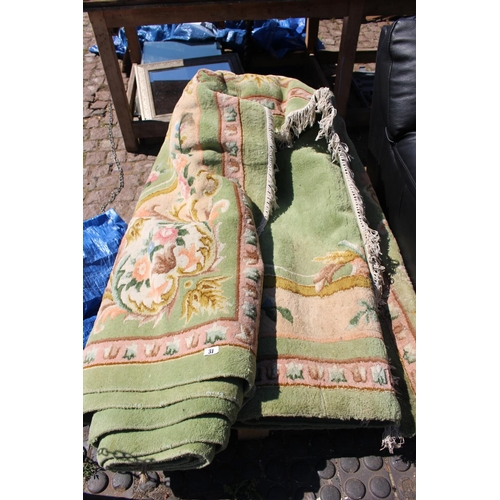 31 - Large Green ground rug with floral...