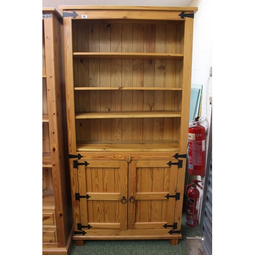 45 - Pine Bookcase with cupboard to base...