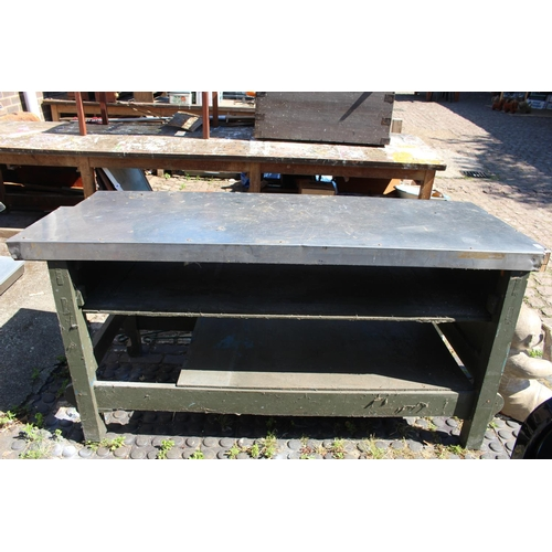 9 - Military metal topped heavy work bench...