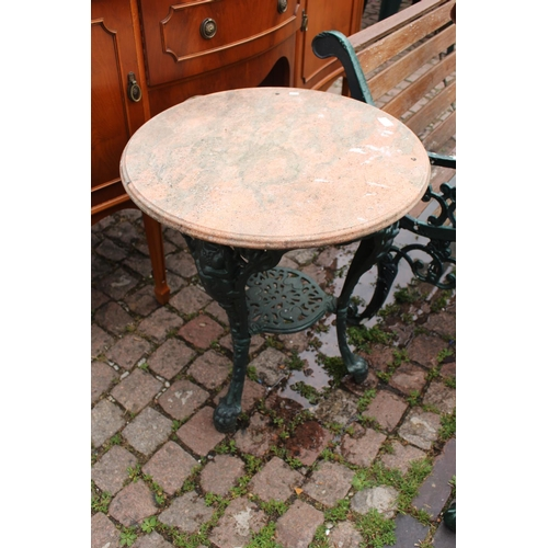 18z - Marble topped Metal green painted table with pierced supports...