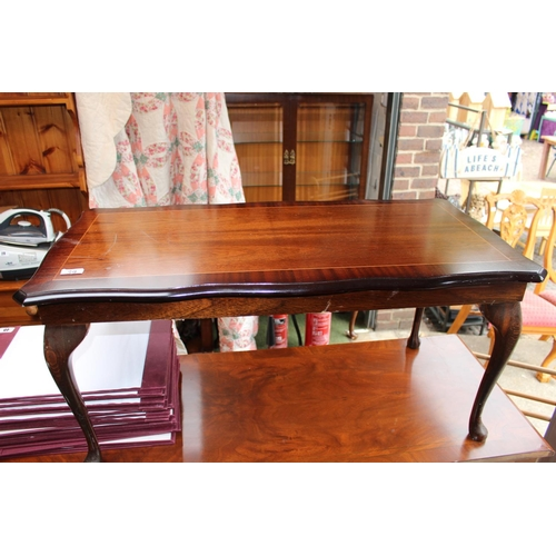 39 - Dark wood coffee table with queen Anne style legs...