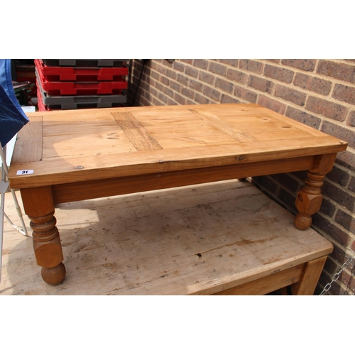 31 - Pine Panelled Coffee Table on turned supports...