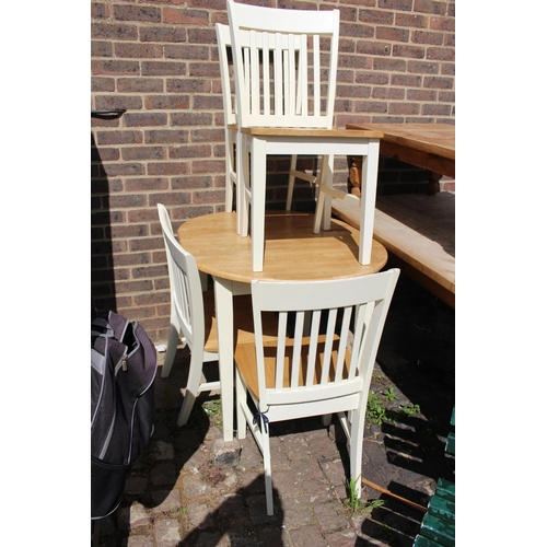 36 - Pine white painted dining suite, table and four chairs....