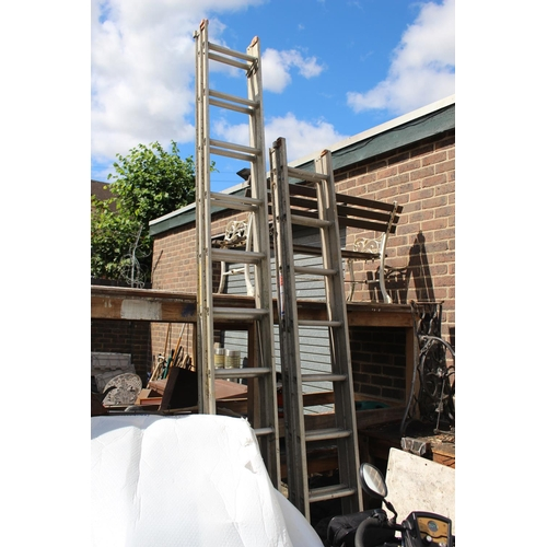 39 - Two large tubular steel ladders...