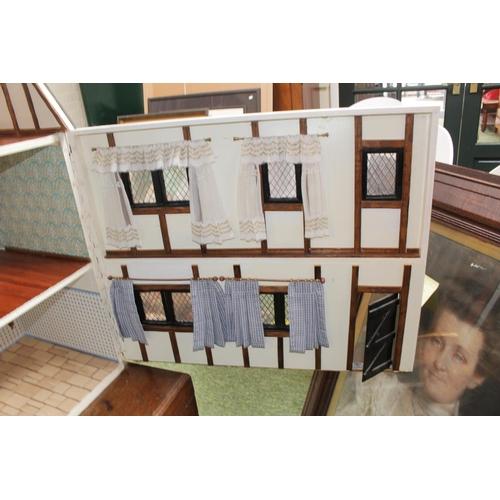 54 - Large 20thC Tudor style Dolls house...