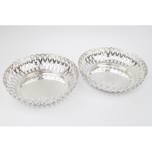 Pair of George V Silver fruit bowls with pierced sides on heavy circular base. 18cm in Diameter. Sheffield 1912 by Kemp Brothers. 440g total weight