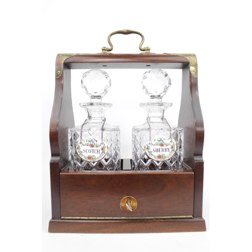 Brass bound Mahogany two bottle tantalus with Scotch and Sherry Labels