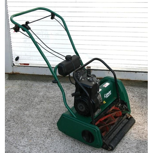14 - A Suffolk Punch petrol cylinder mower with 40cms (16ins) cut, instructions and original bill of sale...