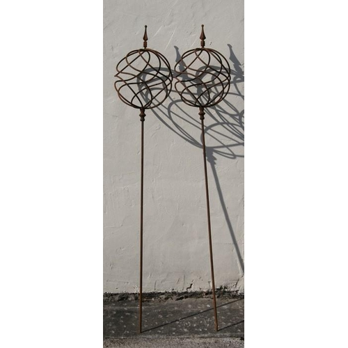 18 - A pair of wrought iron garden obelisks, approx 168cms (66ins) high (2)....