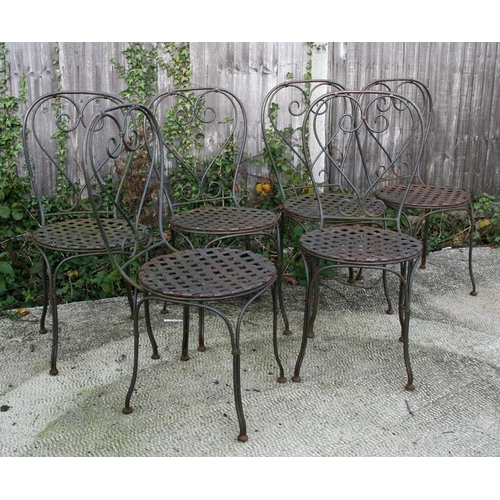 21 - A set of six wrought iron garden chairs with lattice work seats (6)....