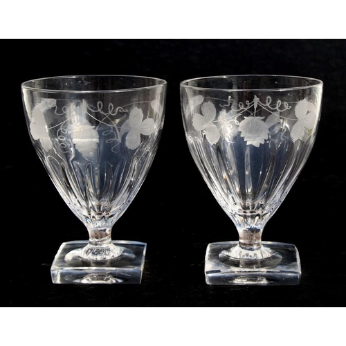 25 - A pair of Georgian ale glasses with engraved wheat and hop decoration, on square bases, 13cm (5 ins)...