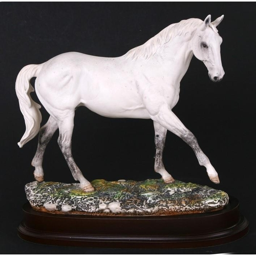 45 - A limited edition Royal Doulton model of a horse - Desert Orchid - numbered 2932/7500, on a wooden p...
