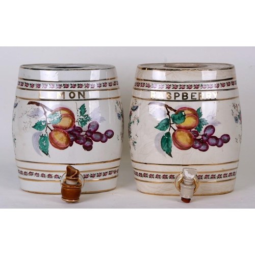 54 - Two pottery spirit barrels, Lemon and Raspberry, each decorated with fruit, each 21cms (8.25ins) wid...