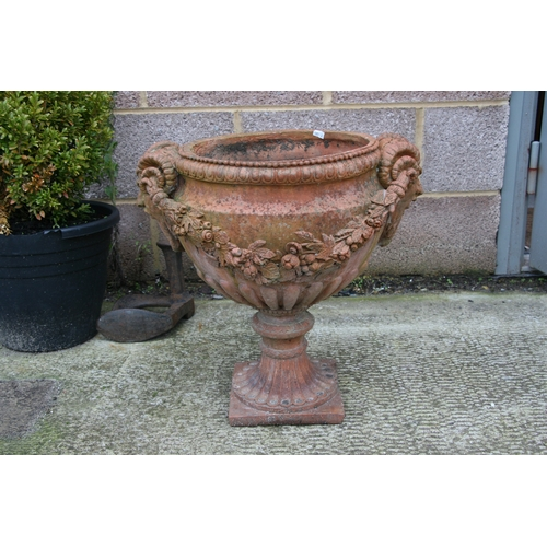 7 - A terracotta urn of classical form, approximately 46cms (18ins) diameter.