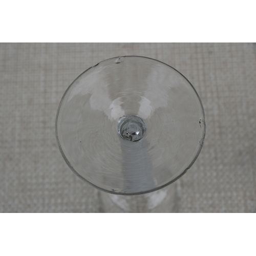 26 - An 18th / 19th century air twist wine glass with double helix to the stem, 16cms (6.25ins) high; tog...