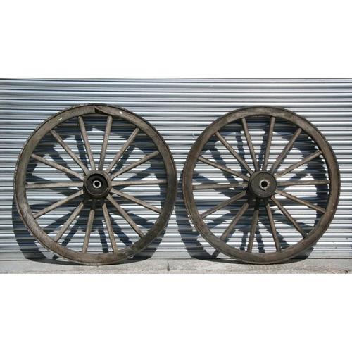 10 - A pair of iron bound cart wheels, 117cms (46ins) diameter (2).