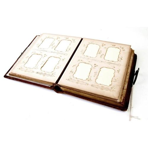 25 - A 19th century leather bound musical carte de visite album (contains no photos).