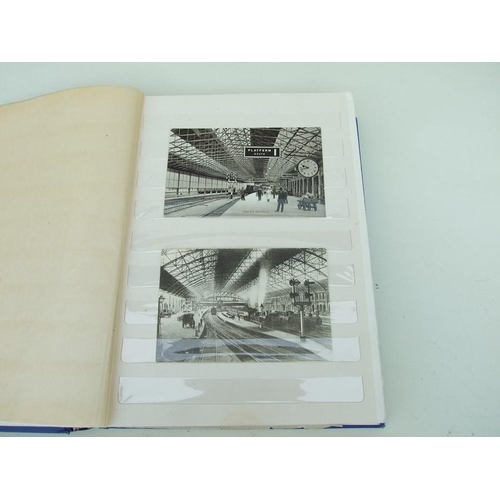 26 - An album of railway related postcards and black and white photos.