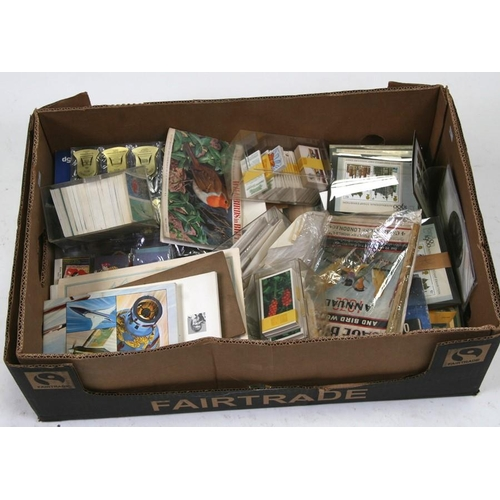 42 - A large quantity of assorted cigarette and trade cards covering various subjects including wildlife ...