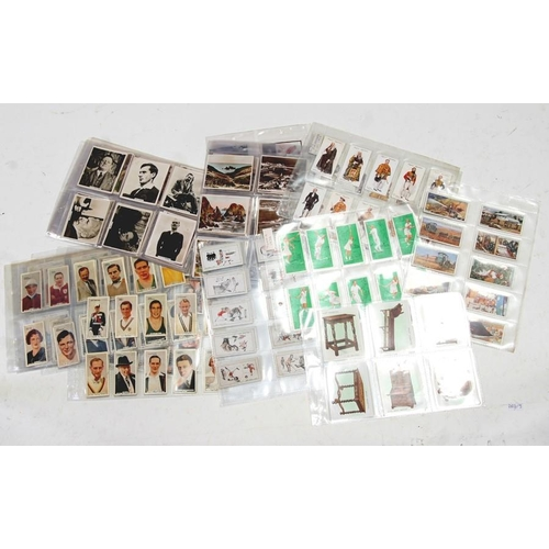 44 - A large quantity of cigarette and trade cards including cinema personalities, topographical, archite...