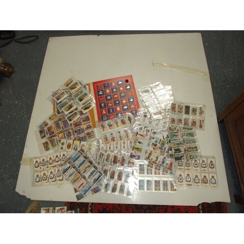 38 - A large quantity of military related cigarette and trade cards covering all subjects including tanks...