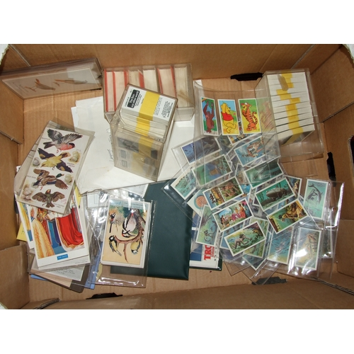 41 - A large quantity of assorted cigarette and trade cards covering all subjects including Disney., pers...