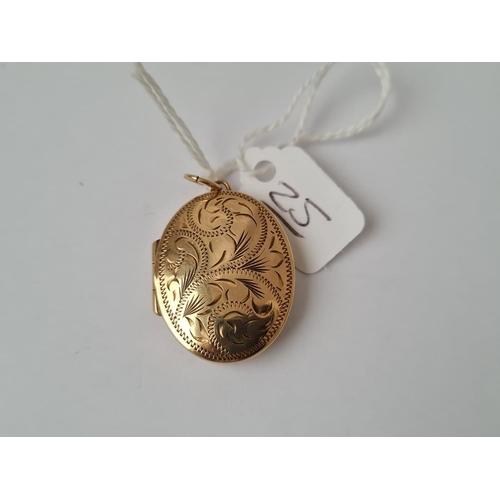 25 - An oval locket in 9ct - 4.2gms