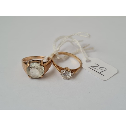29 - Two white stone dress rings in 9ct - size P & L - 5.7gms