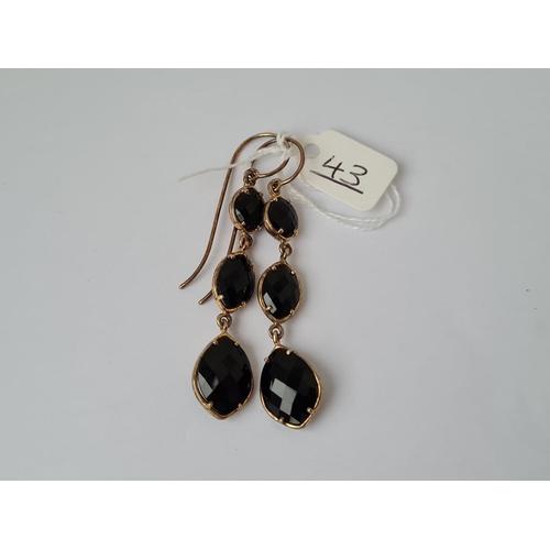 43 - A pair of unusual stone set 3 tier ear pendants